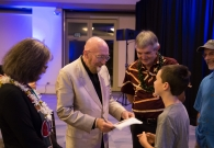 (Left to right) Dr. Thorne's wife Carolee Winstein, Dr. Kip Thorne, and W. M. Keck Observatory Director Hilton Lewis stayed after the event to talk to any guests who had questions, wanted to take pictures and/or get Dr. Thorne's autograph, such as this young fan.