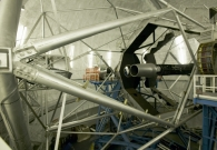 The Keck II telescope primary mirror. The DEIMOS instrument appears in the background. - Rick Peterson