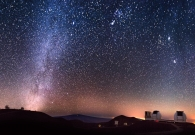 Keck I and II covered in a blanket of stars. - Andrew Hara