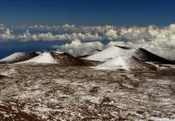 Mauna Kea cinder cones coated in snow. - Pablo McLoud
