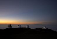 The twin Kecks, Subaru and IRTF seen from the eastern ridge. - Pablo McLoud