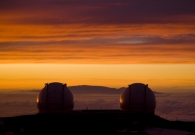 As the sky turns red, the twin Keck domes appear to watch the sun set. - Pablo McLoud