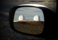 The twni Keck telescopes as seen from a car mirror on the summit. - Pablo McLoud