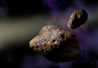 Artist rendering of binary asteroid (617) Patroclus. Scientists at UC Berkeley think this system may have formed from an ancient comet several billion years in the past. The gravitational pull of Jupiter may have split the object in half, resulting in two, almost equal pieces. - Artist Illustration by Lynette Cook