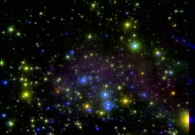 The central starburst region of the dwarf galaxy IC 10. In this composite color image, near infrared images obtained with the Keck II telescope have been combined with visible-light images taken with NASA's Hubble Space Telescope to reveal distinct populations of red and blue stars. - UC Berkeley/NASA/W. M. Keck Observatory